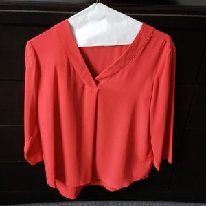 Top, can be paired with skinny jeans or slacks.